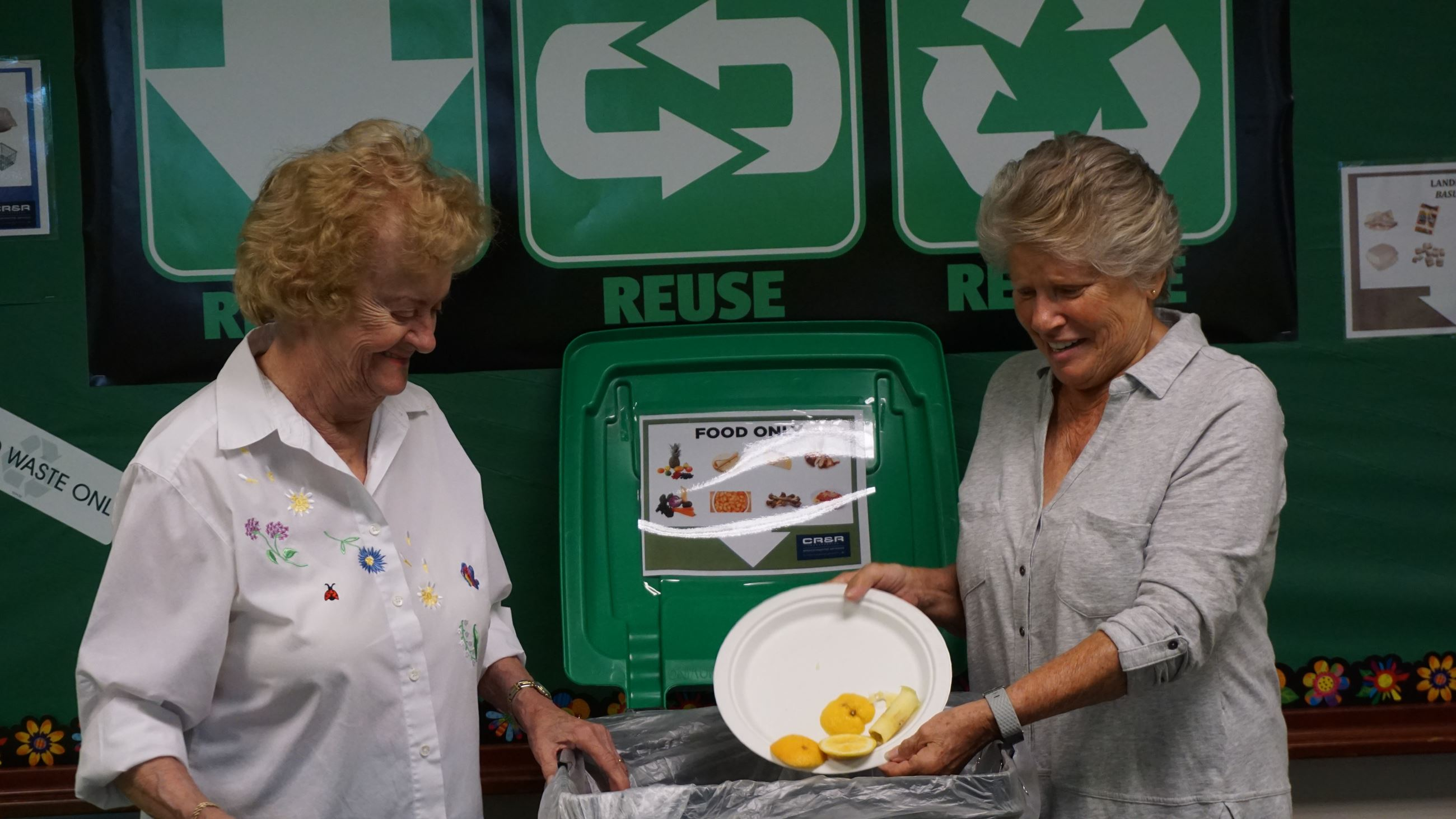 Workers showing how to reduce waste